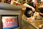 A Dunkin' Donuts store employee pours coffee in this undated file photo. (Source: Reuters)