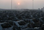 TIANJIN, CHINA - AUGUST 13: (CHINA OUT) Burnt cars are seen in the debris following the explosions of a warehouse in Binhai New Area on August 13, 2015 in Tianjin, China. At least 17 people dead, 32 are in critical condition and at least another 400 injur