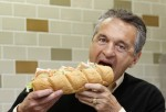 Subway founder Fred DeLuca poses in a Subway branch in central London